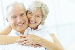 Cosmetic dentistry will make you want to share your smile, like this senior couple.
