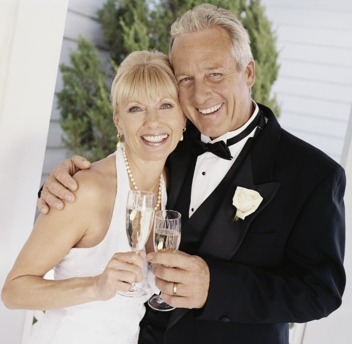 A happt couple getting married thanks to their dental implants from Dr. Kuzma in Wilmington, North Carolina